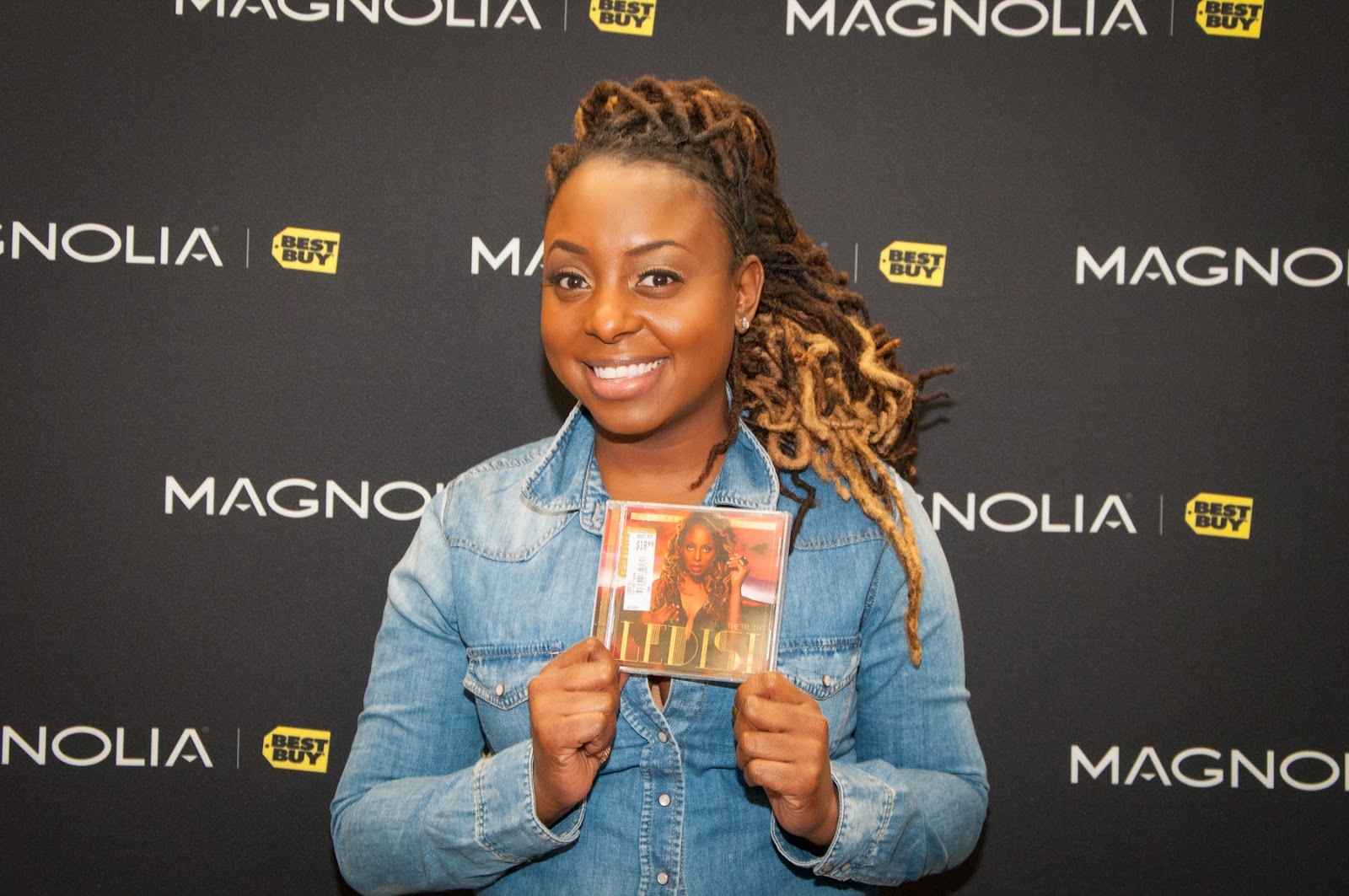 Ledisi holding up her newest release The Truth, Autograph signing, Magnolia Theater Best Buy