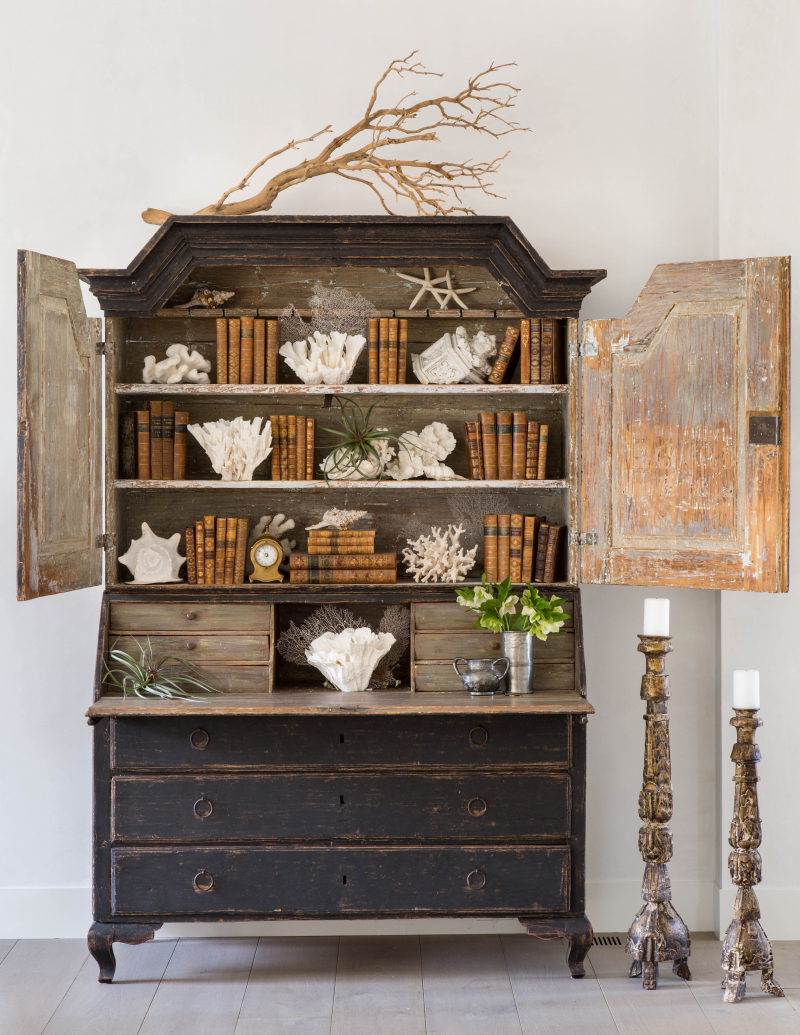 Black painted antique secretary cabinet with shells and antique books by Giannetti Home