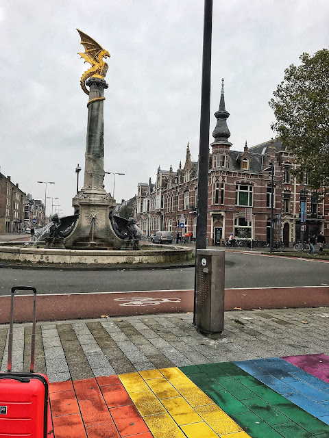 Colourful rainbow road in Den Bosch Netherlands with dragon statue
