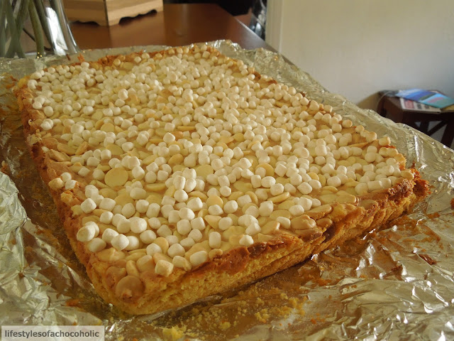 Peanut Butter Marshmallow White Chocolate Bars cooling on a piece of foil