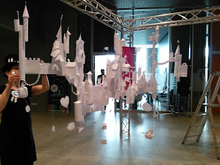 Paper Castles hanging from wires