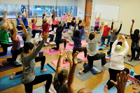 Participants practice tree pose