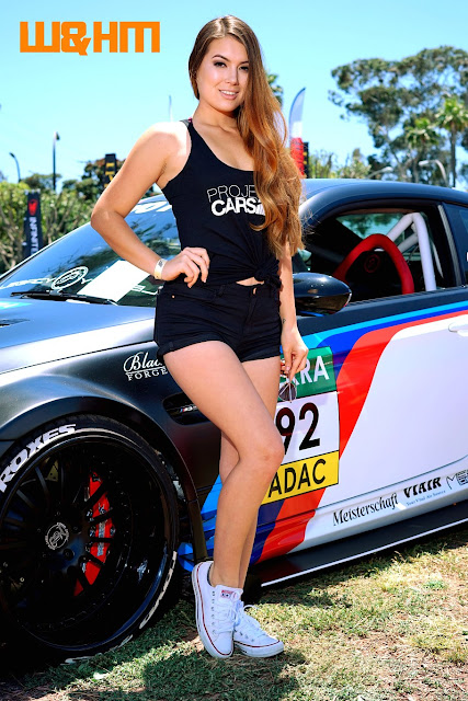 Asian car model Nicole Marie Reckers in black tanktop for Prestige Marketing by their cool modified BMW