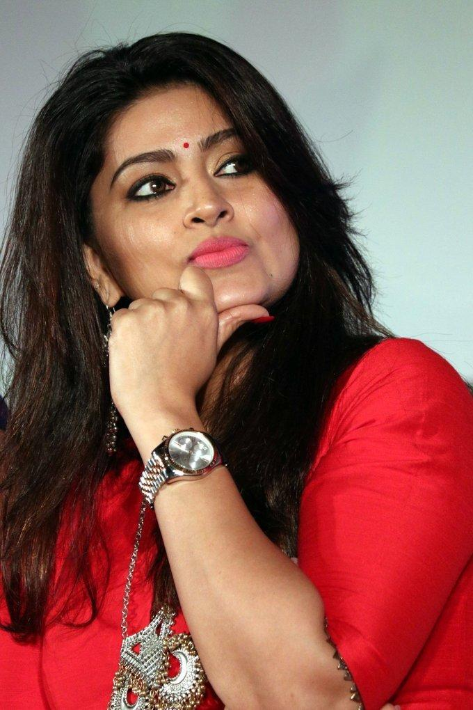 Actress Sneha Smiling Face Close Up In Red Dress