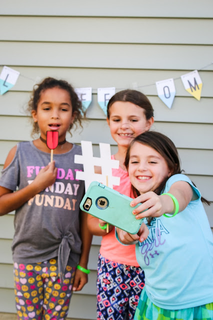 take a selfie at an emoji birthday party