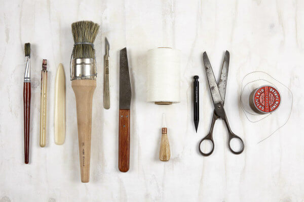 flat lay of ten bookmaking tools