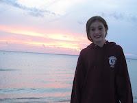 beach sunset girl in sweatshirt