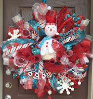 http://www.daisiesandstars.com/2015/10/diy-curly-deco-mesh-snowman-wreath.html