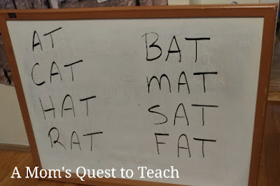 words spelled on white board including: at, cat, hat, rat