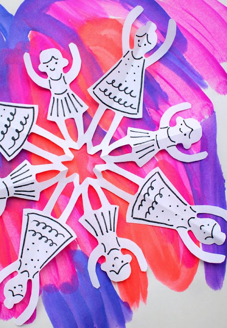 How to cut paper dancer snowflakes