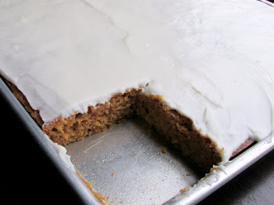 half sheet pan of pumpkin bars with corner piece missing