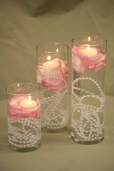 envuelve las velas flotantes con la flor y de desearlo los ptalos utiliza menos para obtener una apariencia ms bsica y elegante y ms para una