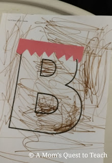 Construction paper hair glued onto letter B