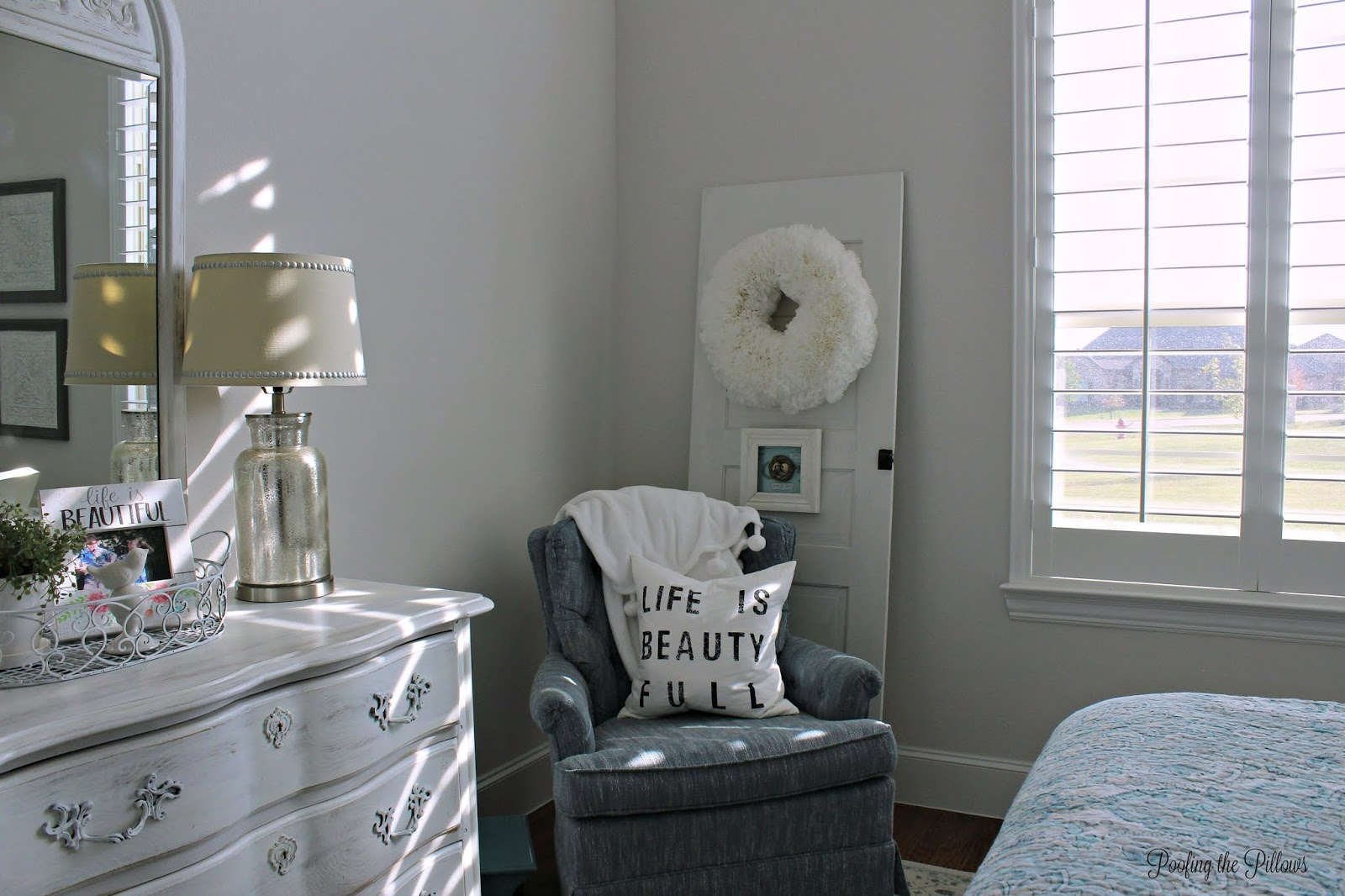 A cottage style guest room, decorated in turquoise, gray, and lots of white. Old pieces have been painted and we shopped the house to make the room pretty and functional. Guests love it!
