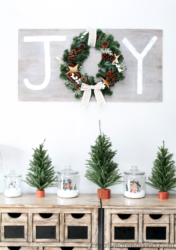 I Hung It Above This Christmas Display Have Set Up On The Back Wall Dressers Are Luna 10 Drawer Accent Chest From Wayfair There Two Next To