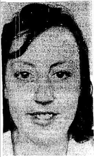 A greyscale portrait picture of a dark haired young woman