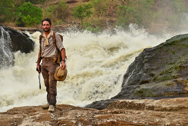 Levison Wood stands at the top of Murchsion Falls, Uganda.