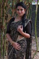 Tamil Actress Sri Priyanka Pos in Saree at Pichuva Kaththi Tamil Movie Audio Launch  0007.JPG