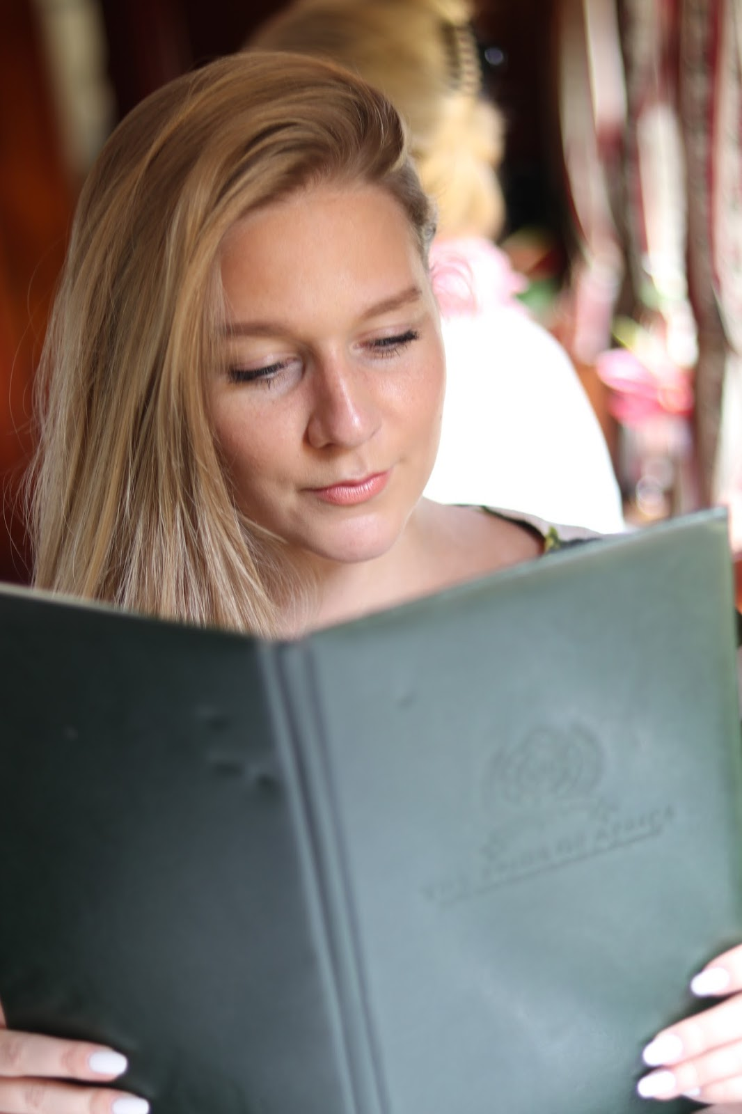 Katie Heath reading the menu aboard Rovos Rail, South Africa