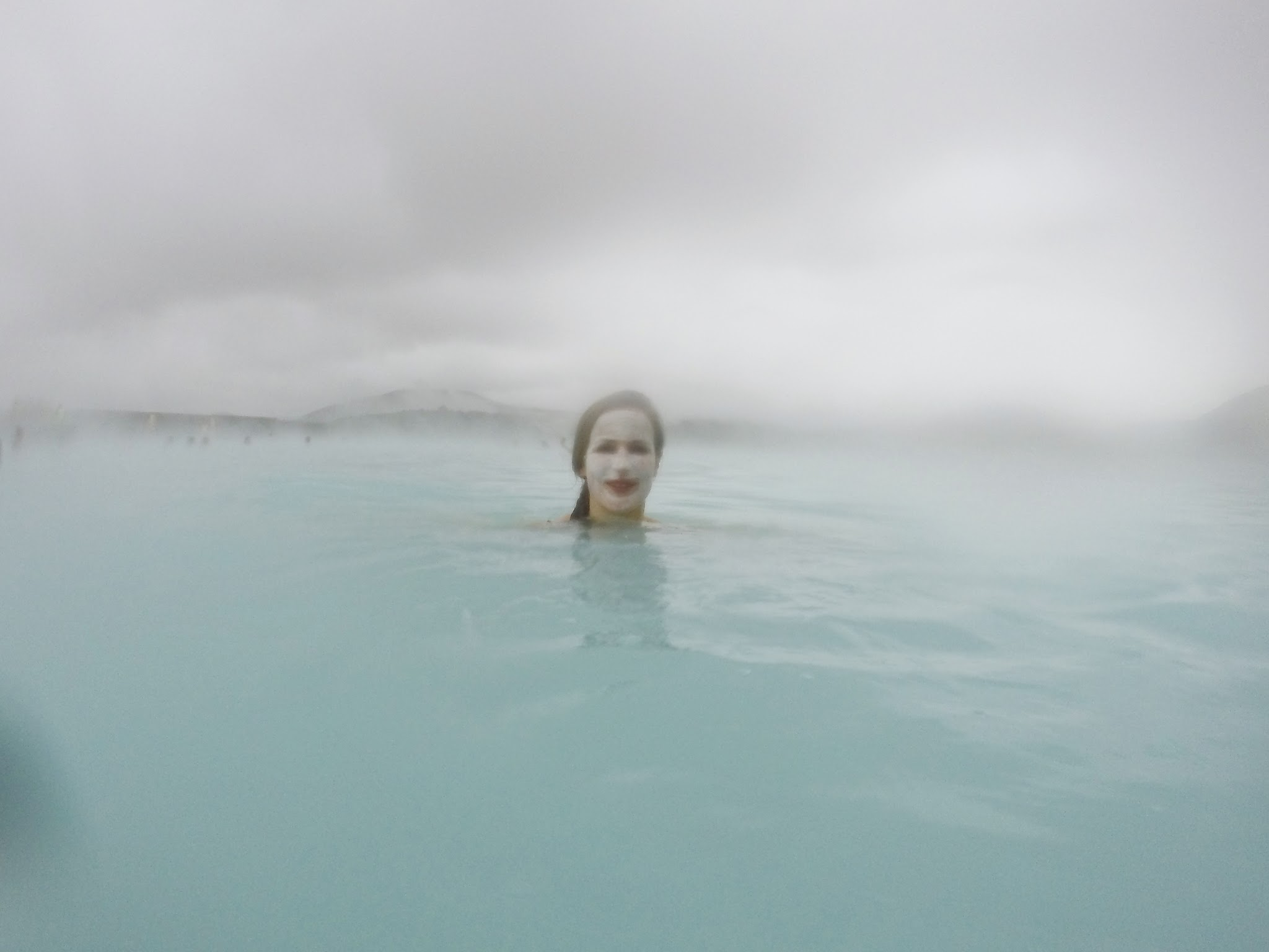 fisheye lens, woman with face mask on in water