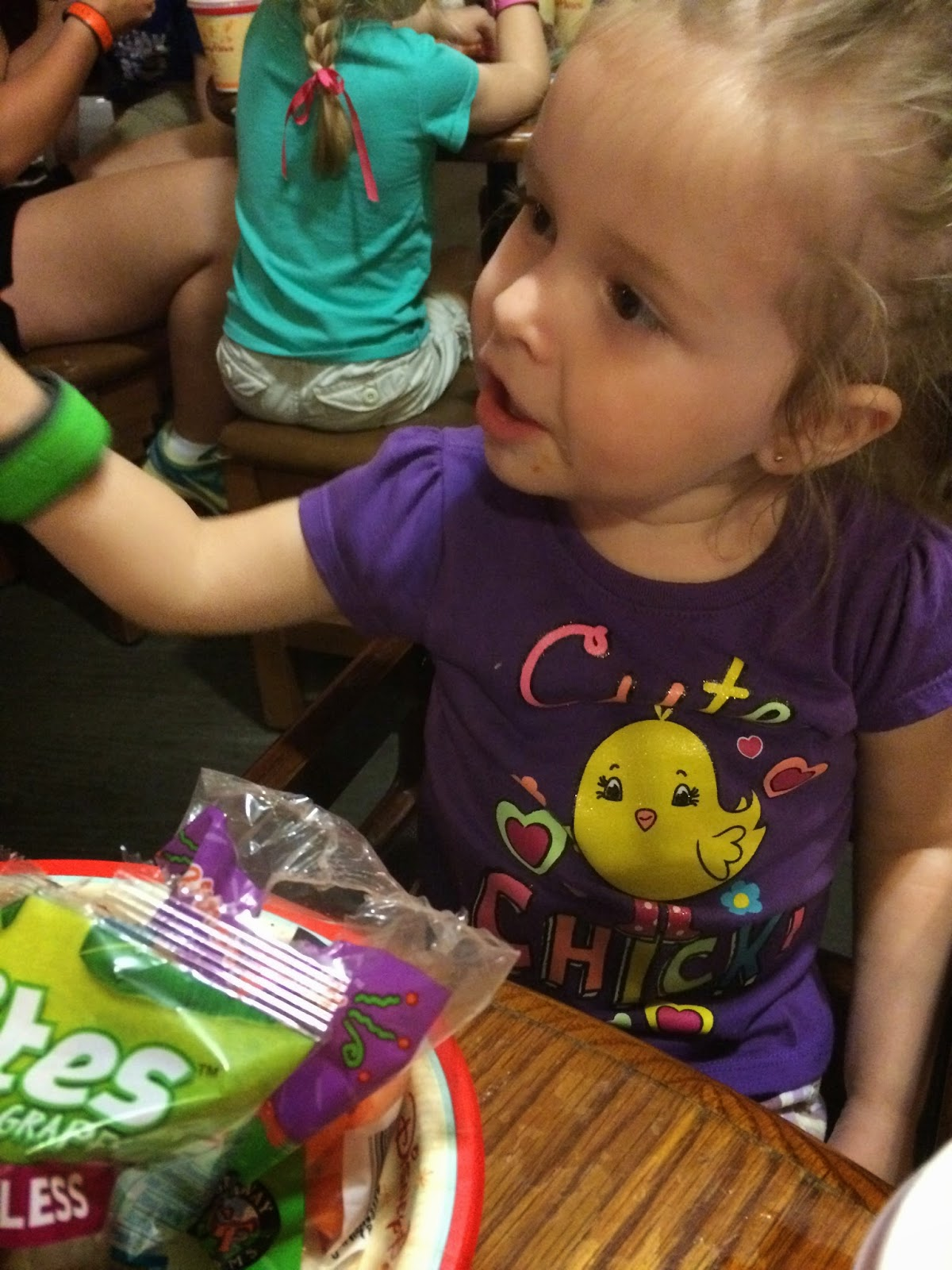 kiddo eating a good meal on Disney World vacation
