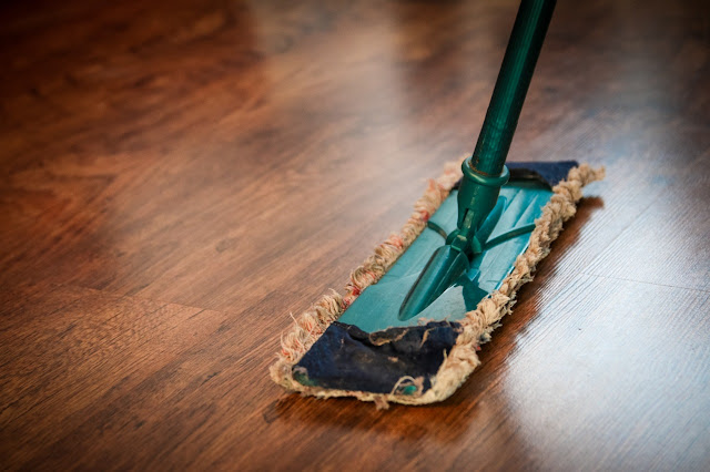 Close up of mop on wooden floor, cleaning, clean