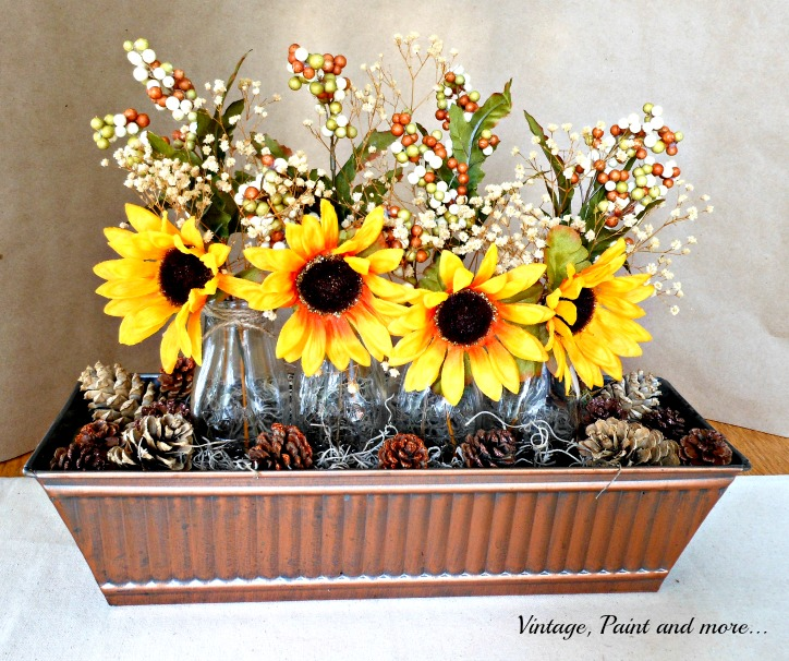 Vintage, Paint and more... faux sunflowers in a vintage bronze trough with pinecones and milk bottles
