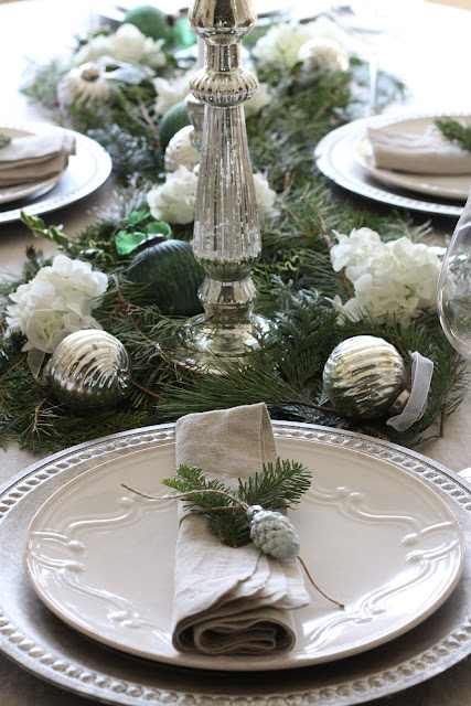 gorgeous holiday tablescape christmas silver candleholders chargers pine branches ornaments