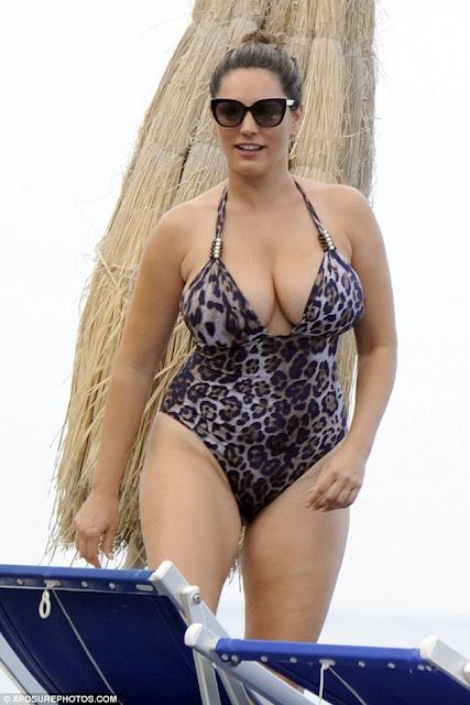 Kelly Brook in bikini goes for a swim in Italy with boyfriend Jeremy Parisi