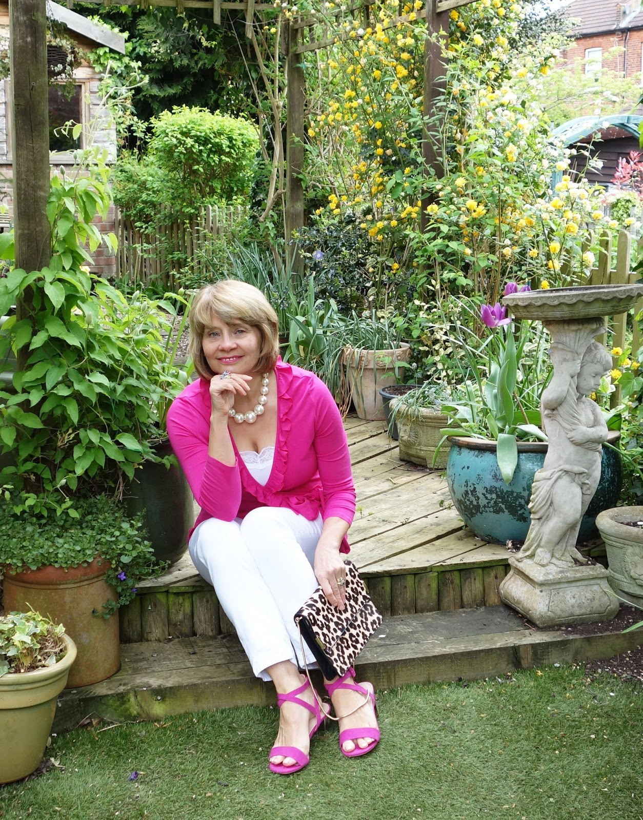 Gail Hanlon, blogger, wearing a fuchsia pink top and sandals from Topshop