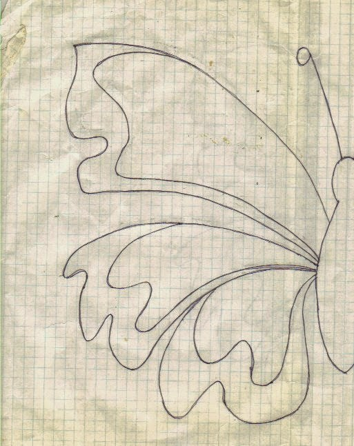 Half butterfly design created on graph paper to transfer to evenweave fabric