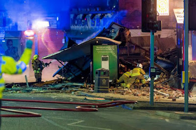 Massive explosion rocks a convenience shop IN Leicester, claiming four lives, leaving four others hospitalized at the Leicester Royal Infirmary - with two reportedly in critical condition.    Leicester Police confirmed  that four people were killed in the explosion and urge people not to comment about the cause of the blast as it's an on-going investigation in a joint operation with firefighters.    About sixty properties have allegedly been evacuated as part of emergency response to ensure the safety of the people living near the epicenter.    A witness, Savannah George, 17, who is an employee at a nearby shop spoke to Mirror Online: