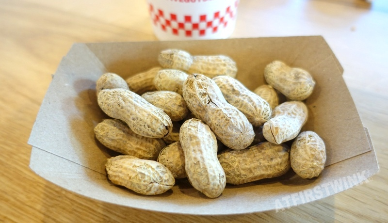 Utrecht Centraal Station Five Guys burger restaurant free peanuts