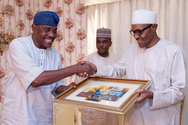 President Buhari presents painting, award to IG of Police Arase
