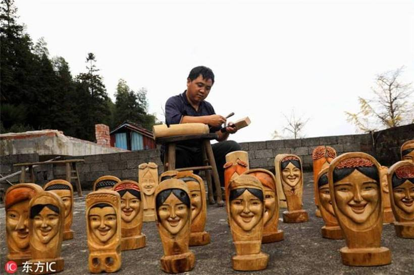Wood carved with smiling faces