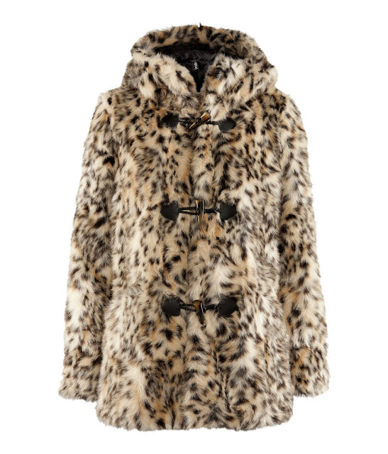 Koska värikäs tai huomiotaherättävällä kuosilla varustettu takki dominoi  helposti muuta asukokonaisuutta 26542d2383