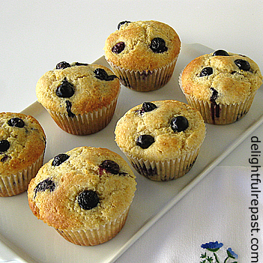 Blueberry Cornmeal Muffins ( this photo - 6 muffins on a white ceramic tray) / www.delightfulrepast.com