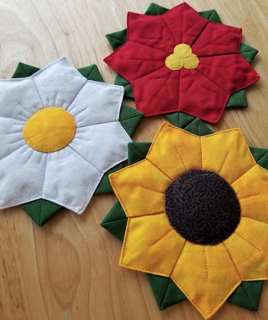 poinsettia, sunflower, and daisy coasters