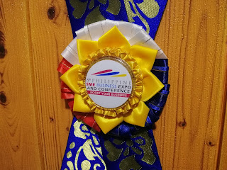 Close-up shot of the rosette leis given to guest speakers of the 8th Philippine SME Business Expo and Conference