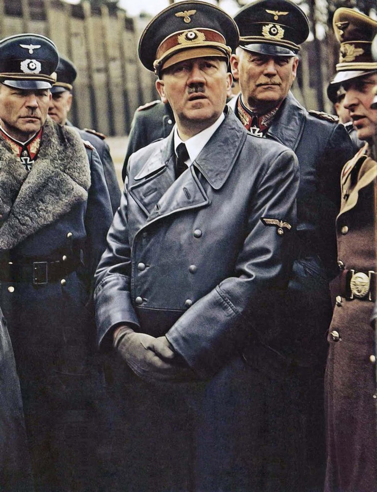 I know the center of attention here is Hitler - which is how he liked it (and probably why he dated a photographer, by the way). But the one who stands out in this shot is Heinz Guderian on the left. You have got to be a real badass to get away with that pimp collar in the middle of a bunch of killers.