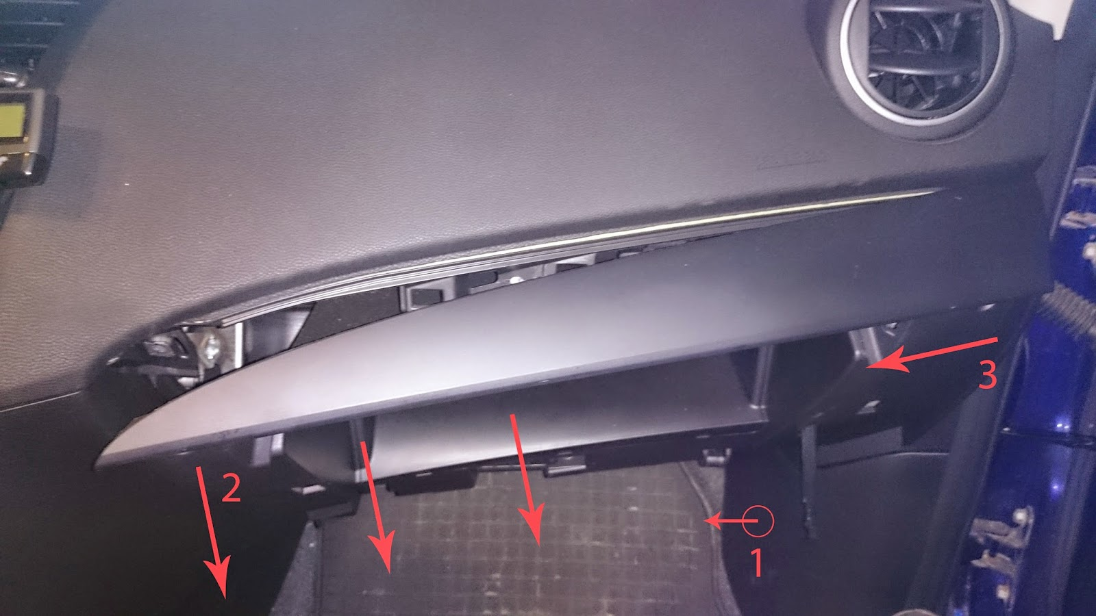 while the screwdriver is in the hole pull it towards you to detach the lower panel you will need some force to do that the dashboard holds together quite  [ 1600 x 900 Pixel ]