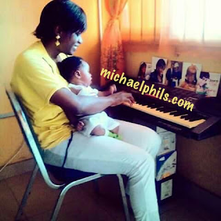 mother playing way maker by sinach on the keyboard