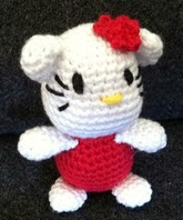 http://www.ravelry.com/patterns/library/amigurumi-tiny-kitty