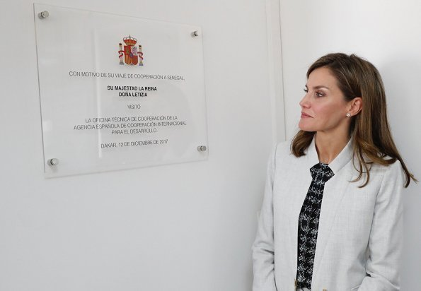 Queen Letizia wore Carolina Herrera blouse, Hugo Boss pantsuit at Spanish Cooperation Agency in Dakar