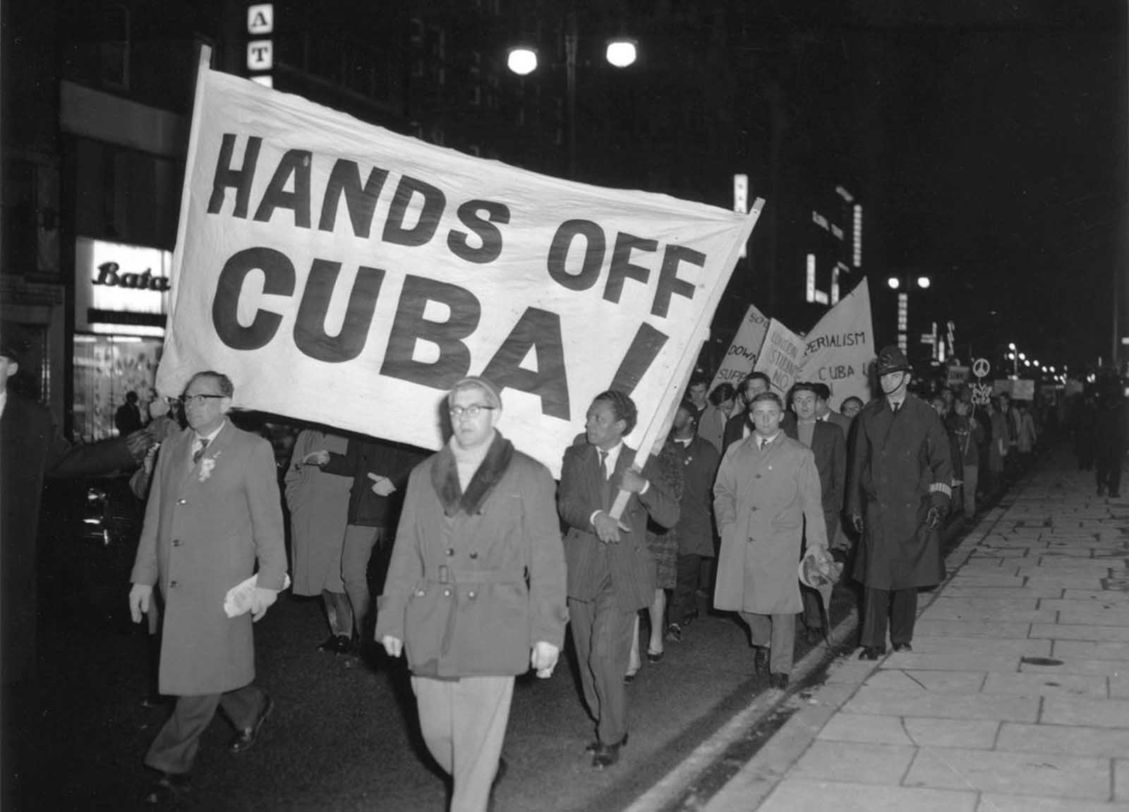 Members of the Campaign for Nuclear Disarmament (CND) march during a protest against the U.S. action over the Cuban missile crisis, on October 28, 1962 in London, England.