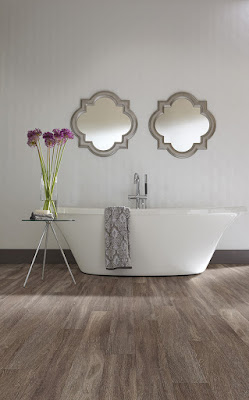 Hardwood in a bathroom? Yes! If you use waterproof resilient flooring