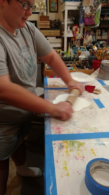 Julia rolling out the paper clay