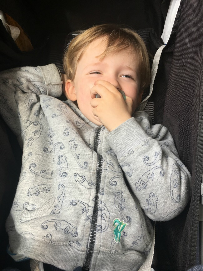 #MySundayPhoto-Number-16-imge-of-relaxed-toddler-laughing-one-hand-over-mouth-and-other-hand-behind-head