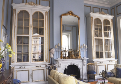 Tall French Bookcases With Glass Doors Are So Elegant In This Formal Living Room