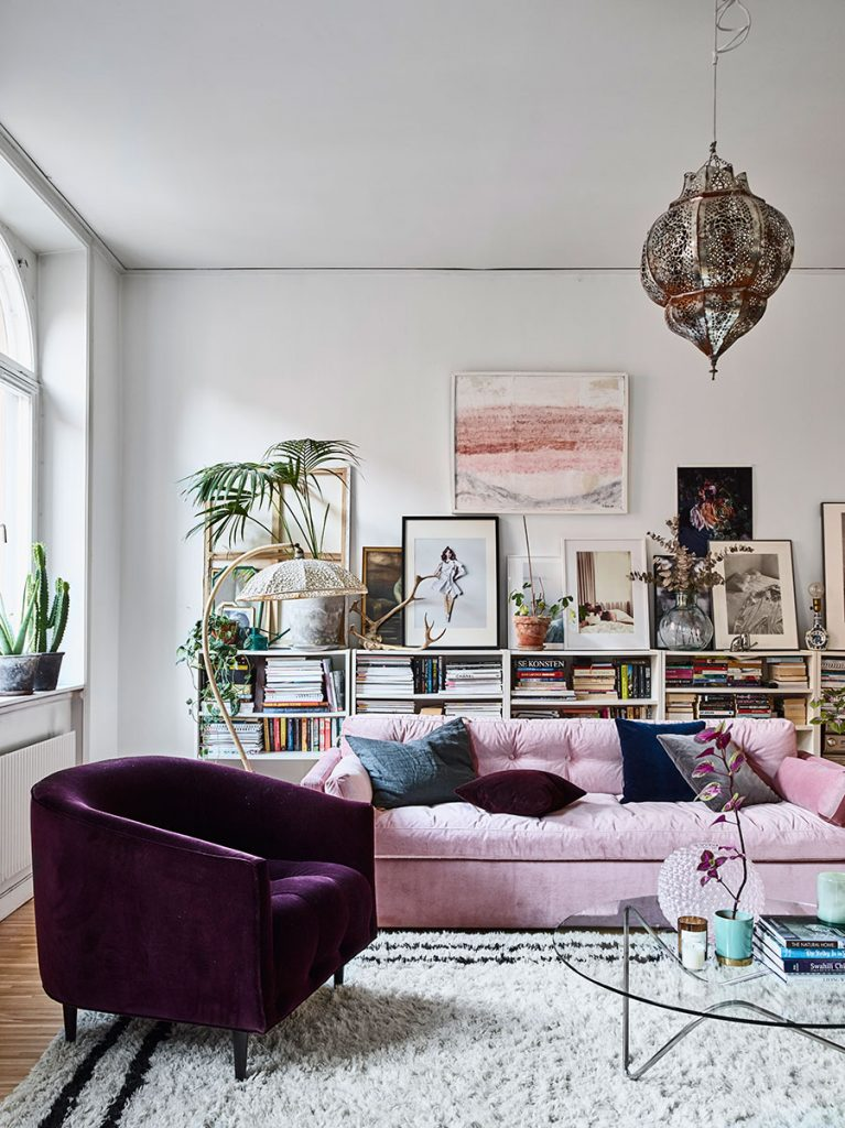 Beautiful and colorful living room- looove that pink sofa! -designaddictmom